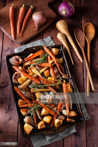roasted root vegetables - rutabaga stock pictures, royalty-free photos & images