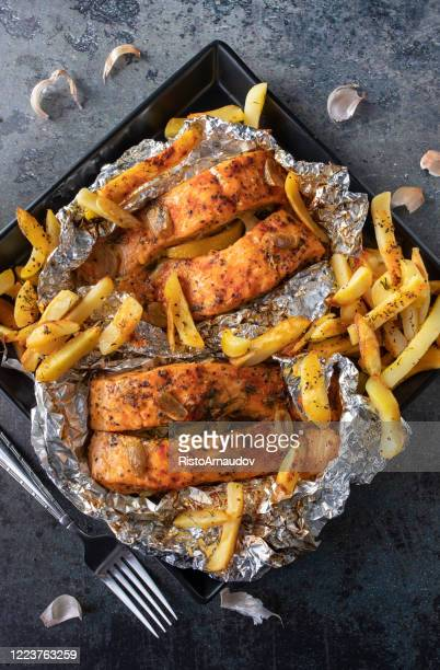 roasted salmon, french fries and wine - crockery stock pictures, royalty-free photos & images
