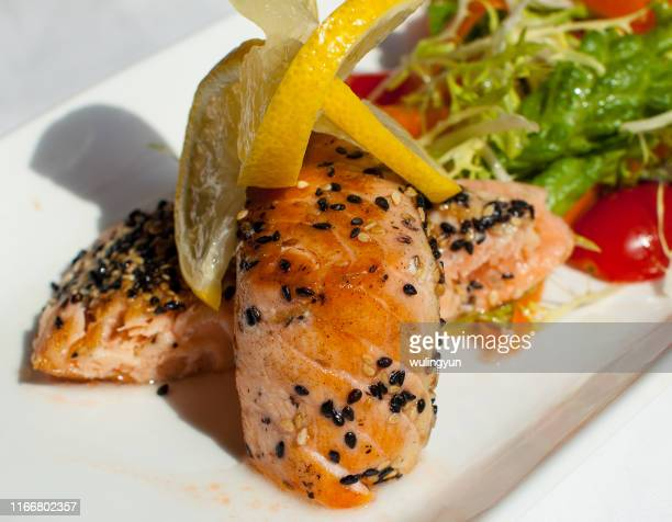 roasted salmon steaks with sesame and vegetable - sesame stock pictures, royalty-free photos & images