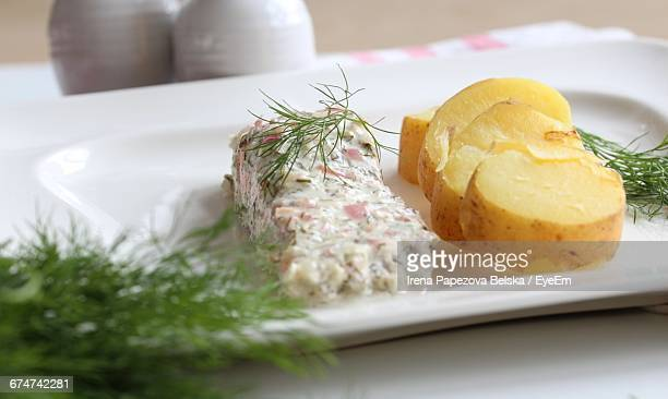 Roasted Salmon With Creme Fraiche In Plate On Table