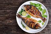 roasted sea bream fish with lemon slices