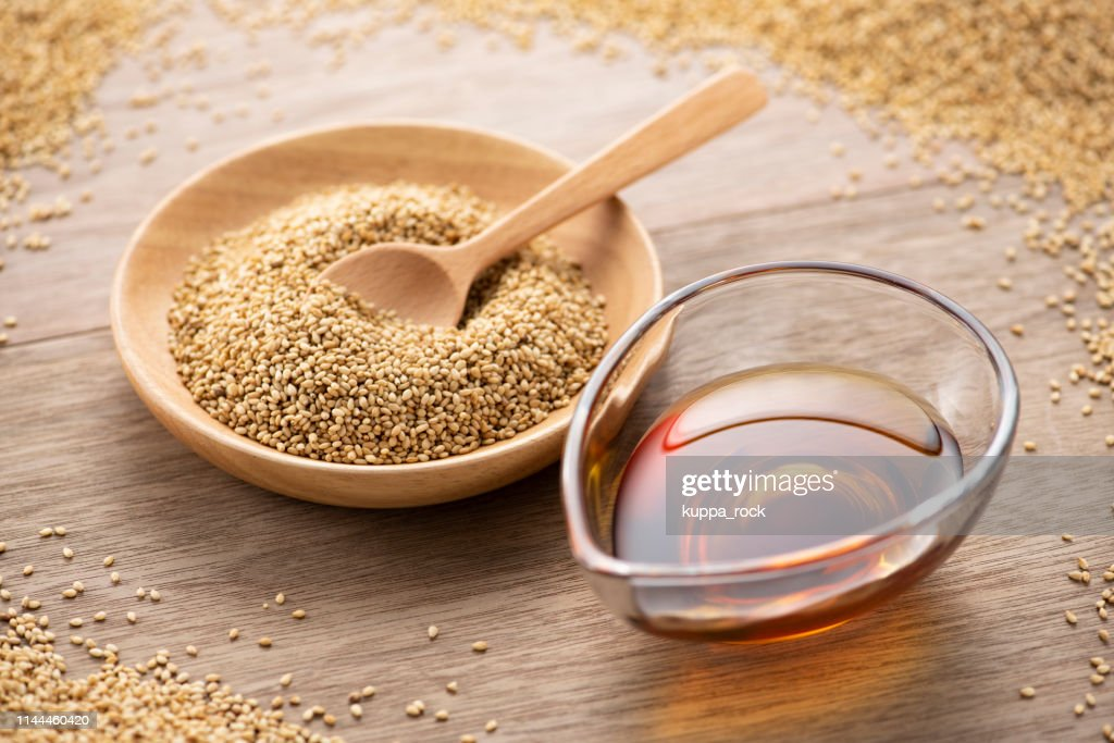 Roasted sesame seeds and sesame oil : Stock Photo