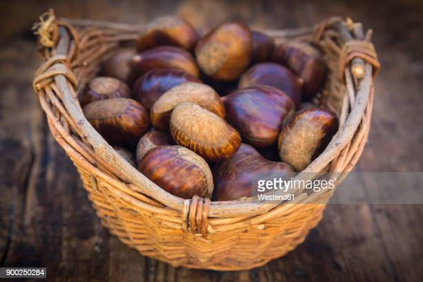 roasted sweet chestnuts in a basket - chestnut food stock pictures, royalty-free photos & images
