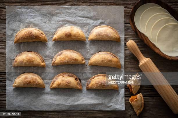 roasted sweet potato patties pie empanadas food homemade - empanada stock pictures, royalty-free photos & images
