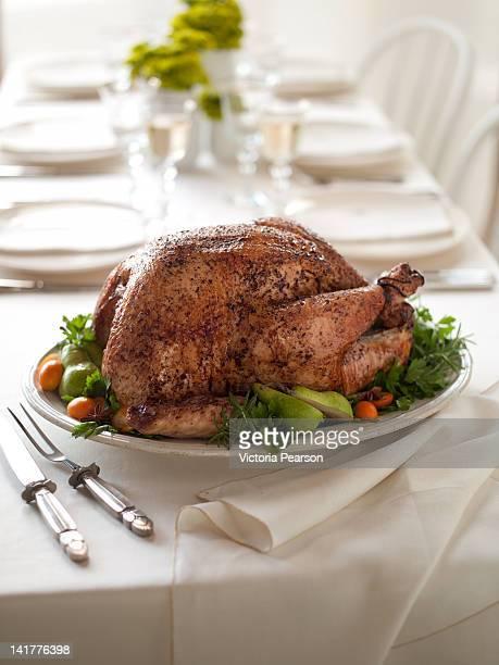 roasted thanksgiving turkey presented on table. - ローストターキー ストックフォトと画像