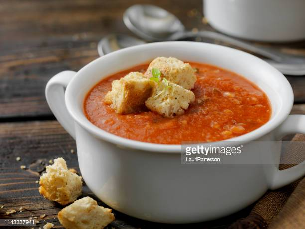 roasted tomato, garlic and basil soup croutons - soup bowl stock pictures, royalty-free photos & images