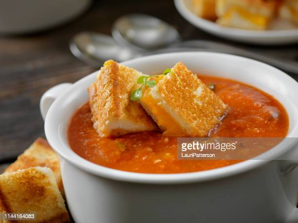 roasted tomato, garlic and basil soup with grilled cheese croutons - soup stock pictures, royalty-free photos & images
