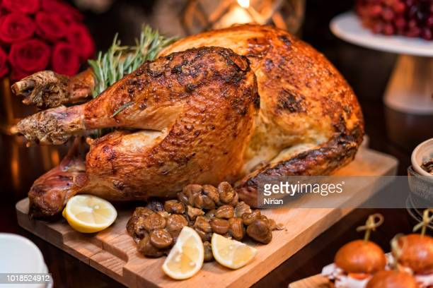roasted turkey on holiday table - turkey stock pictures, royalty-free photos & images