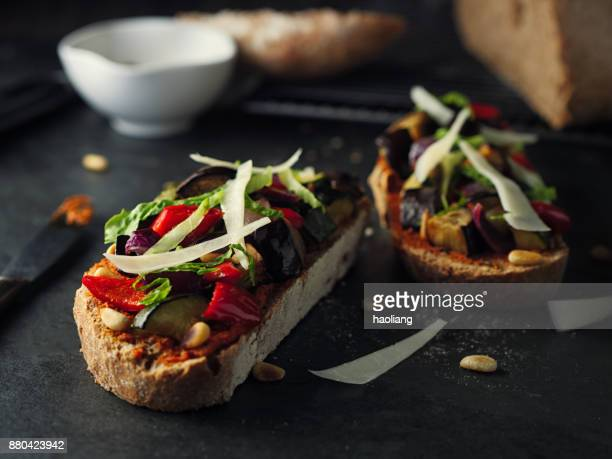 Roasted vegetable bruschetta with goat cheese and pine nuts