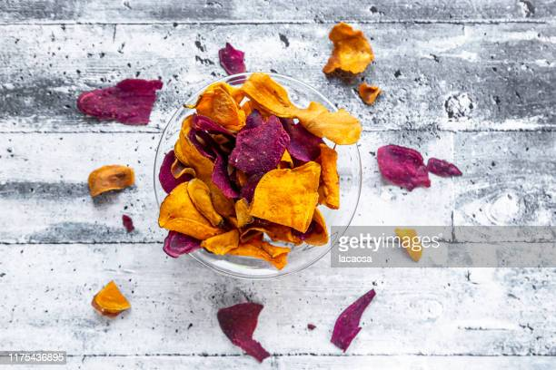 roasted vegetable chips in a bowl - root vegetable stock pictures, royalty-free photos & images