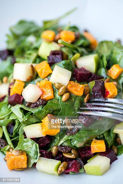 Roasted Vegetable Salad arugula spinach butternut squash beets granny smith apples raisins pumpkin seeds and roasted garlic vinaigrette at Hawthorne