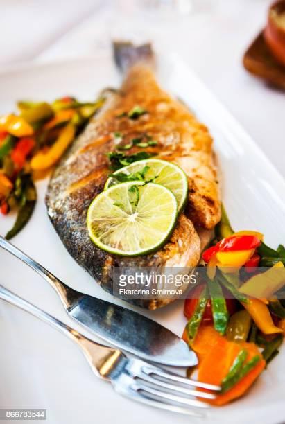 Roasted whole sea bream fish (dorado) with vegetables