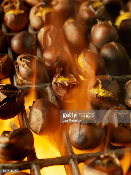 roasting chestnuts on an outdoor bbq - chestnut food stock pictures, royalty-free photos & images