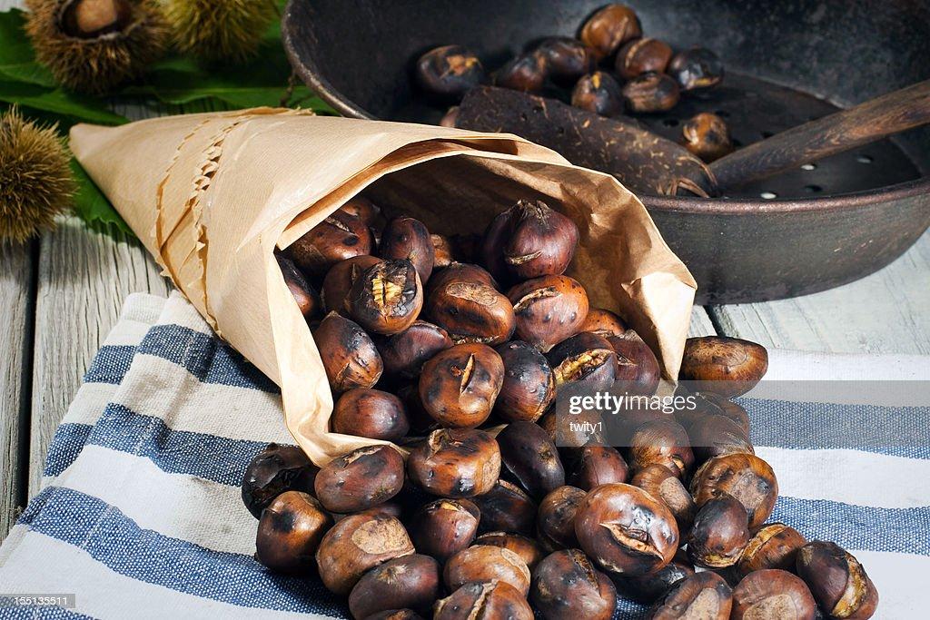Roasting chestnuts : Stock Photo