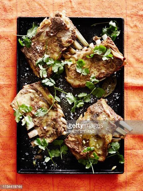 roasting tin of kashmiri tabak maaz (lamb ribs) - indian food stock pictures, royalty-free photos & images