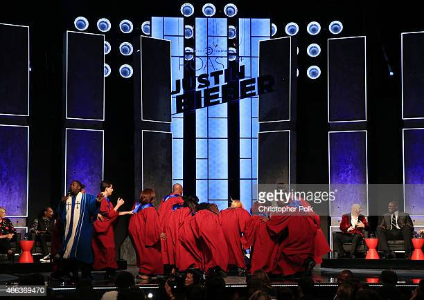 Roastmaster Kevin Hart and gospel choir perform onstage at The Comedy Central Roast of Justin Bieber at Sony Pictures Studios on March 14 2015 in Los...