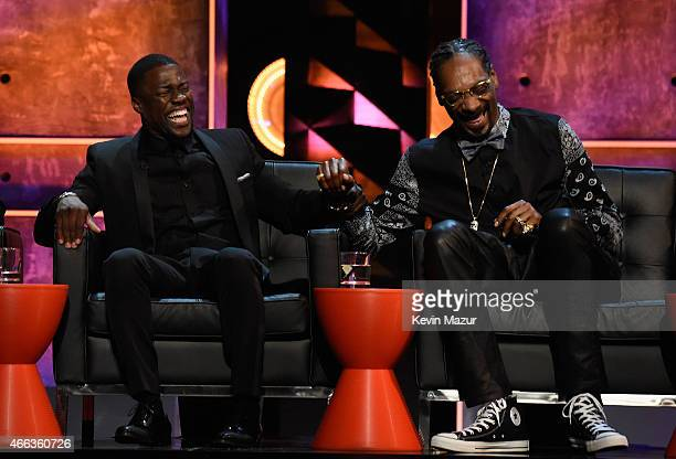 Roastmaster Kevin Hart and recording artist Snoop Dogg speak onstage at The Comedy Central Roast of Justin Bieber at Sony Pictures Studios on March...