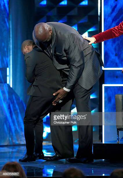 Roastmaster Kevin Hart and TV personality/retired basketball player Shaquille O'Neal onstage at The Comedy Central Roast of Justin Bieber at Sony...
