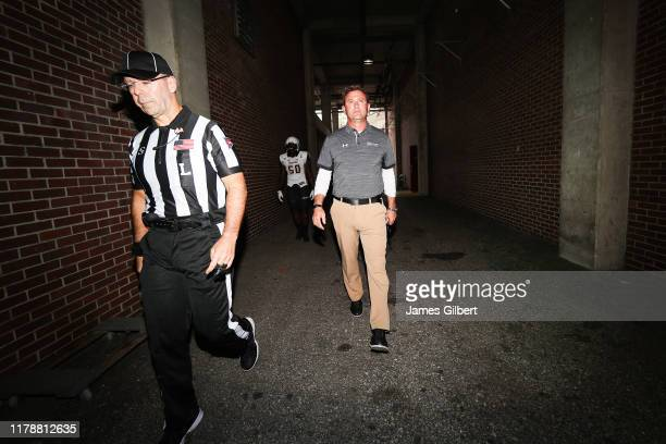 Rob Ambrose head coach of the Towson Tigers exits the locker room before the start of a game against the Florida Gators at Ben Hill Griffin Stadium...