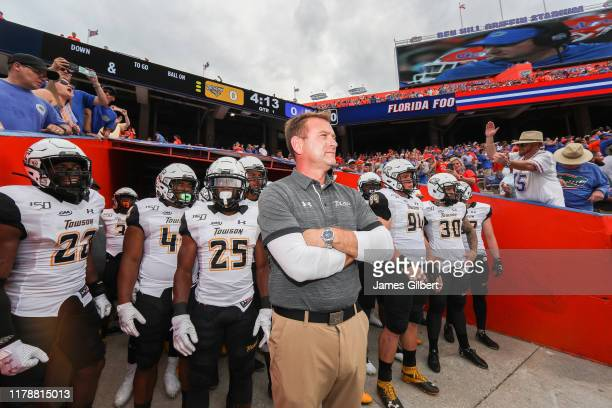 Rob Ambrose head coach of the Towson Tigers waits to take the field before the start of a game against the Florida Gators at Ben Hill Griffin Stadium...