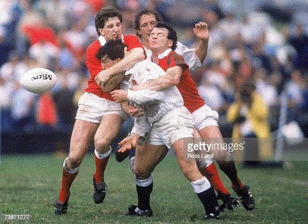 Rob Andrew of England is tackled by Jonathan Davies and Ieuan Evans of Wales during the 1987 Rugby World Cup Quarter-Final match between Wales and...