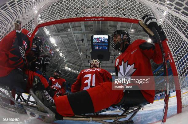 Rob Armstrong of Canada and team mate Dom Cozzolino look dejected after losing the gold medal game against United States in the Ice Hockey gold medal...