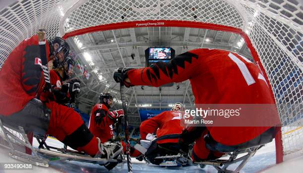 Rob Armstrong of Canada looks dejected after losing the gold medal game against United States in the Ice Hockey gold medal game between Canada and...