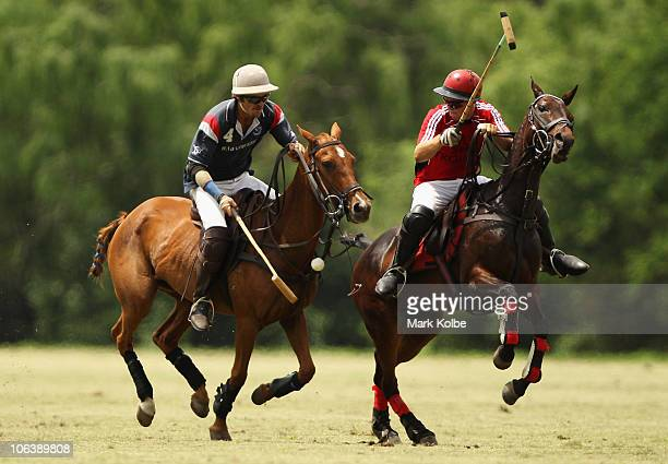 Rob Ballard of Town Country B knocks the ball forward during the Hector King Cup Day at the Windsor Polo Club on October 31 2010 in Sydney Australia