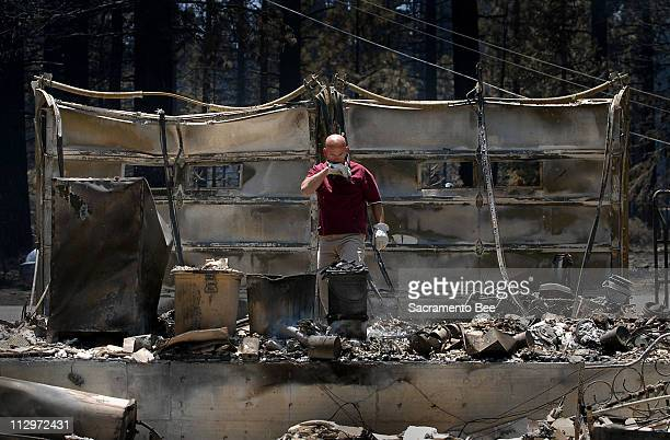 Rob Beaty sifts through the remains of his mother's home in South Lake Tahoe, California, June 26, 2007.
