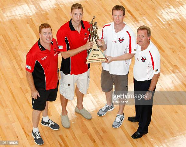 Rob Beveridge and Shawn Redhage of the Wildcats together with Gordie McLeod andMat Campbell captain of the Hawks pose with the NBL Trophy during the...
