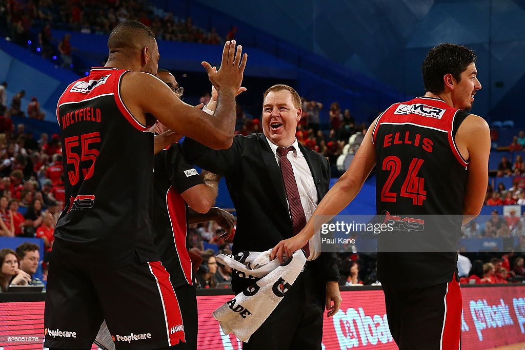 Rob Beveridge, head coach of the Hawks celebrates with players after winning the round eight NBL match between the Perth Wildcats and the Illawarra Hawks at the Perth Arena on November 27, 2016 in Perth, Australia.