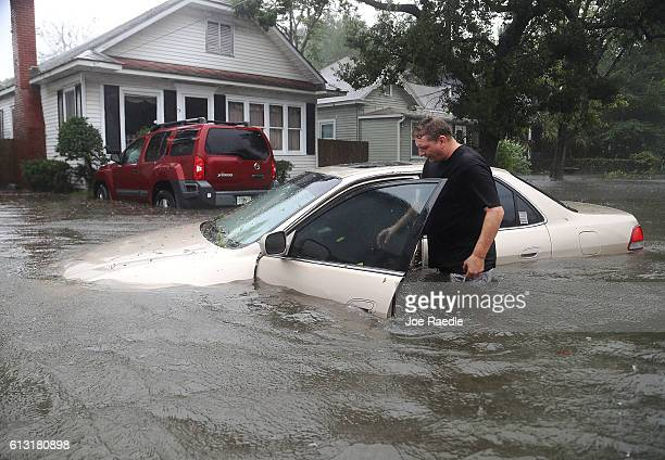 Rob Birch checks on his car which floated out of his drive way as Hurricane Matthew passes through the area on October 7 2016 in St Augustine Florida...