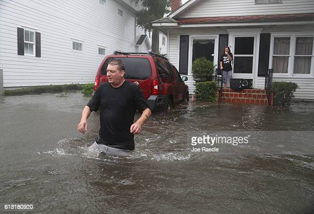 Rob Birch walks out of his home into the flooded street as Hurricane Matthew passes through the area on October 7 2016 in St Augustine Florida...