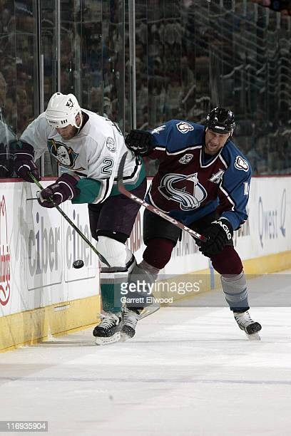 Rob Blake of the Colorado Avalanche fits for puck against Todd Marchant of the Mighty Ducks of Anaheim during Game 3 of the Western Conference...