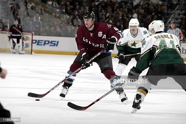 Rob Blake of the Colorado Avalanche skates against Martin Skoula of the Dallas Stars during the game on January 26 2006 at Pepsi Center in Denver...