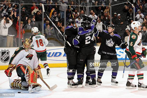 Rob Blake of the Los Angeles Kings celebrates with teammates Alexander Frolov and Patrick O'Sullivan his third period goal against Josh Harding of...