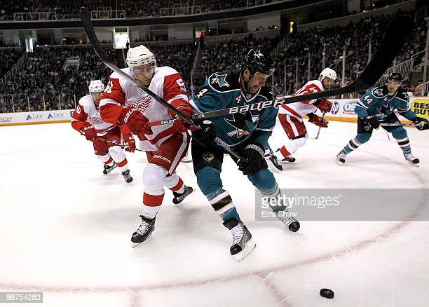 Rob Blake of the San Jose Sharks and Valtteri Filppula of the Detroit Red Wings go for the puck in Game One of the Western Conference Semifinals...