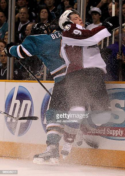 Rob Blake of the San Jose Sharks checks Matt Duchene of the Colorado Avalanche into the glass in Game Two of the Western Conference Quarterfinals...