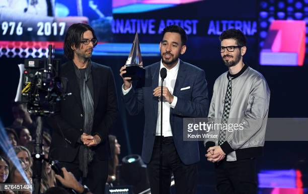 Rob Bourdon Mike Shinoda and Brad Delson of music group Linkin Park accept the Favorite Artist Alternative Rock award onstage during the 2017...