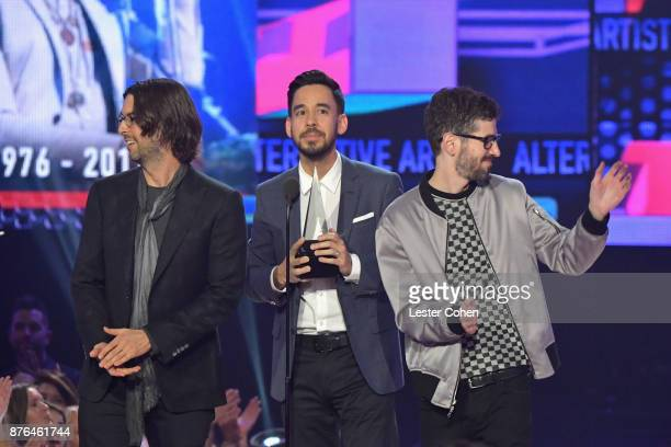 Rob Bourdon Mike Shinoda and Brad Delson of the band Linkin Park accept award onstage during the 2017 American Music Awards at Microsoft Theater on...