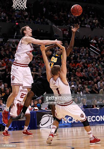 Rob Brandenberg of the Virginia Commonwealth Rams goes up for a shot between Cody Zeller and Jordan Hulls of the Indiana Hoosiers in the second half...