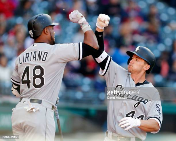 Rob Brantly of the Chicago White Sox celebrates with Rymer Liriano as he returns to the dugout after hitting a solo home run against the Cleveland...