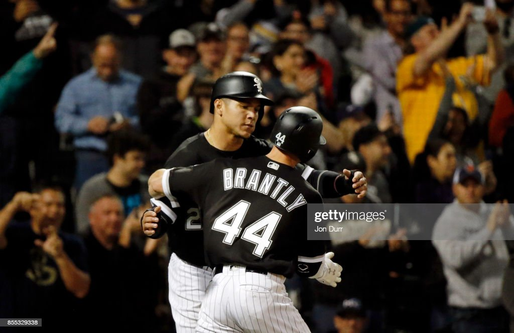 Rob Brantly #44 of the Chicago White Sox is congratulated by Avisail Garcia #26 after hitting a two run home run against the Los Angeles Angels of Anaheim during the eighth inning at Guaranteed Rate Field on September 28, 2017 in Chicago, Illinois. The Chicago White Sox won 5-4.