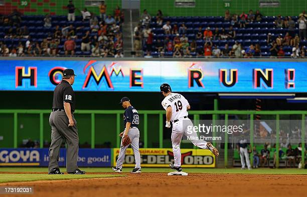 Rob Brantly of the Miami Marlins hits a three run home run durimg a game at Marlins Park on July 9 2013 in Miami Florida