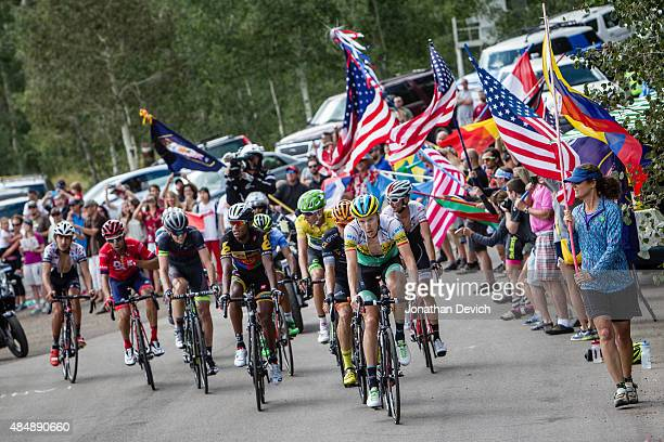 Rob Britton of Team SmartStop leading the front group through fans on the final climb of stage 7 of the Tour of Utah on August 9 2015 in Park City...