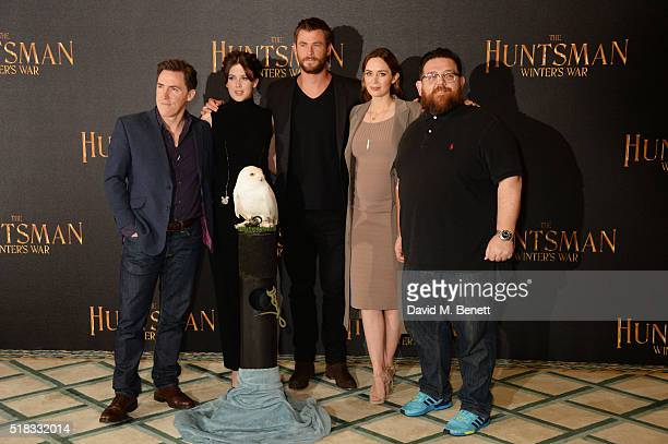 Rob Brydon Alexandra Roach Chris Hemsworth Emily Blunt and Nick Frost pose at a photocall for The Huntsman Winter's War at Claridges Hotel on March...