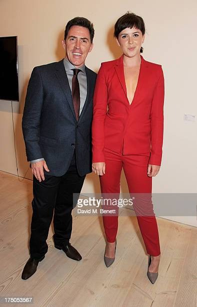 Rob Brydon and Alexandra Roach attend a private view of 'HUGO Red Never Follows' celebrating 20 years of Hugo Boss at the Saatchi Gallery on July 30...
