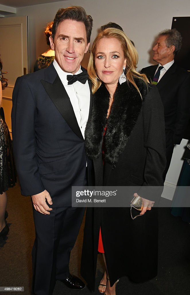 Rob Brydon (L) and Gillian Anderson attend a champagne reception ahead of The London Evening Standard Theatre Awards in partnership with The Ivy at The Old Vic Theatre on November 22, 2015 in London, England.