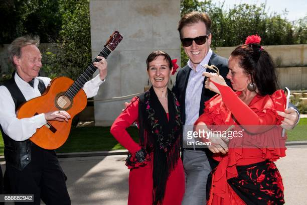 Rob Brydon poses with traditional Spanish flamenco dancers at the RHS Chelsea Flower Show on May 22 2017 in London United Kingdom With Their...