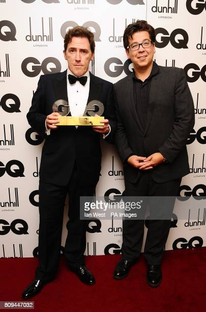 Rob Brydon with the Comedian of the Year award, presented by Michael McIntyre, at the 2011 GQ Men of the Year Awards at the Royal Opera House, Covent...